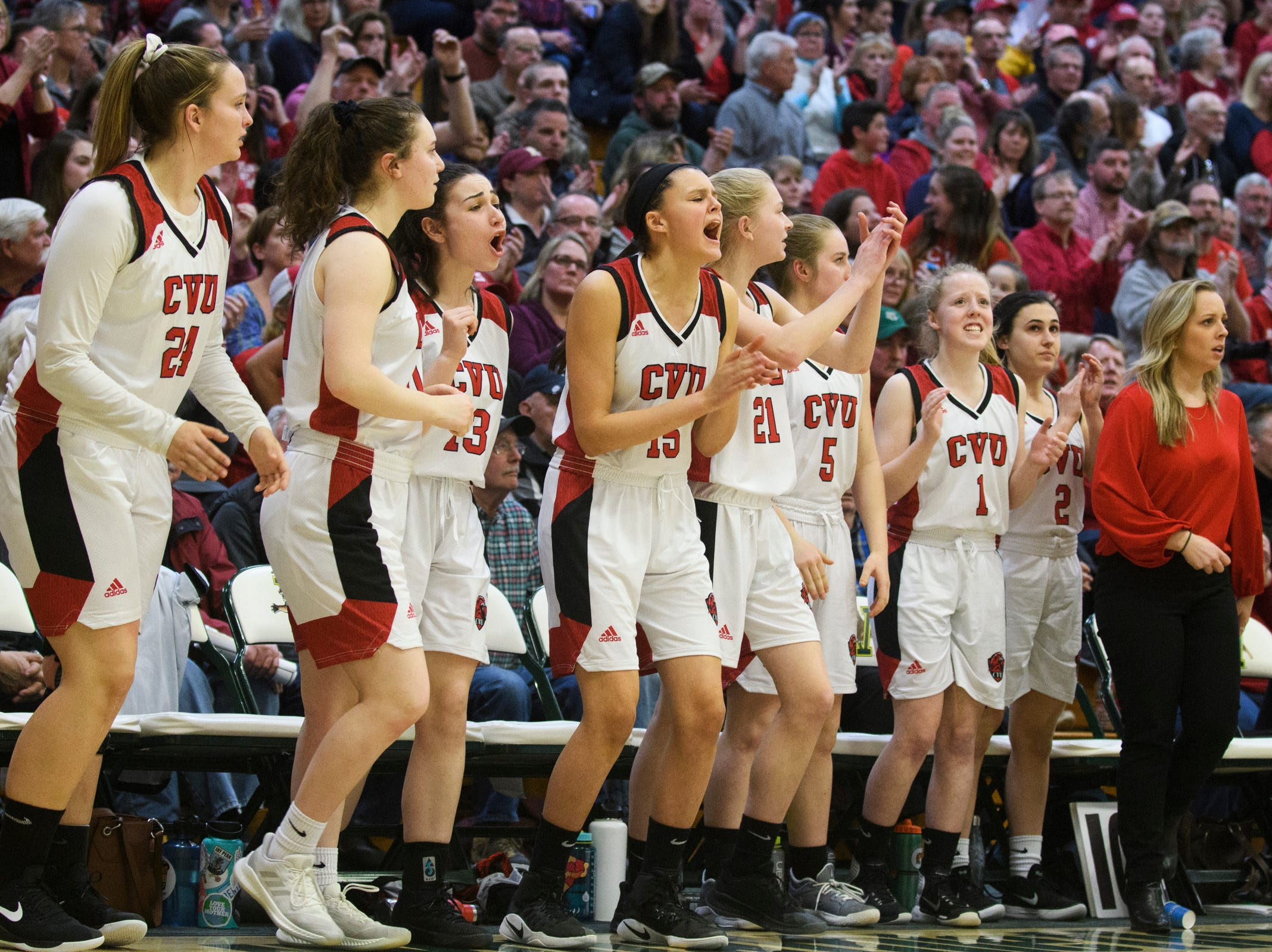 The CVU bench cheers for the team during the division I girls basketball championship basketball game between the St. Johnsbury Hilltoppers and the Champlain Valley Union Redhawks at Patrick Gym on Sunday afternoon March 10, 2019 in Burlington, Vermont.