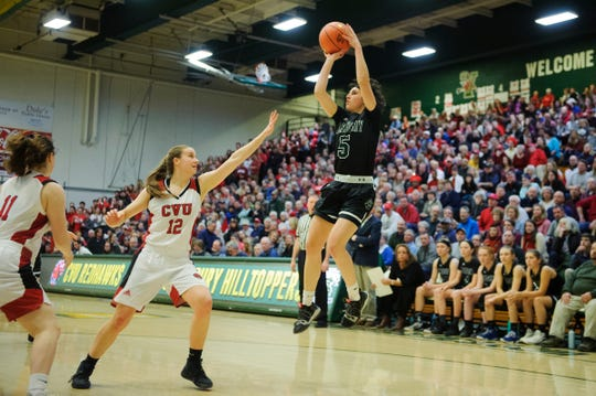 St. Johnsbury's Sadie Stetson (5) shoots the ball over CVU's Harper Mead (12) in last month's Division I final.