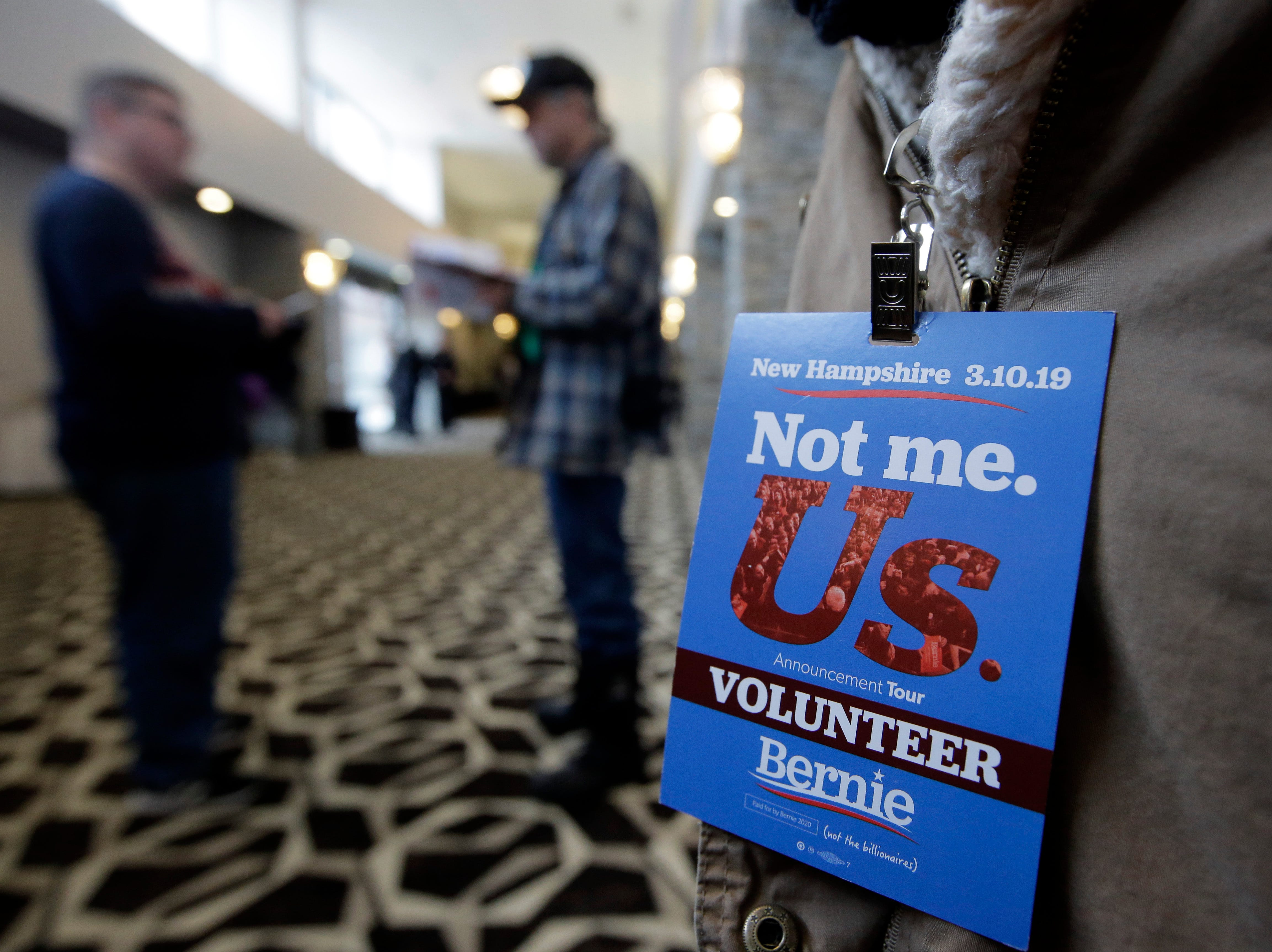 A volunteer wears a credential before the start of a campaign event for 2020 Democratic presidential candidate Sen. Bernie Sanders, Sunday, March 10, 2019, in Concord, N.H.