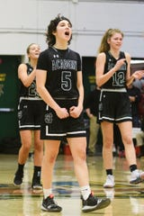 St. Johnsbury's Sadie Stetson (5) cheers during the division I girls basketball championship basketball game between the St. Johnsbury Hilltoppers and the Champlain Valley Union Redhawks at Patrick Gym on Sunday afternoon March 10, 2019 in Burlington, Vermont.