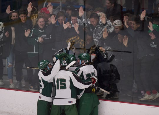Rice celebrates Ryan Byrnes' third-period goal against Champlain Valley that lifted the Green Knights to a 1-0 win in the Division I boys hockey semifinals on Saturday night in South Burlington