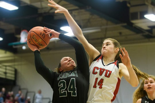 CVU's Julia Blanck (14) goes up to a block a shot in last season's Division I high school girls basketball championship vs. St. Johnsbury.