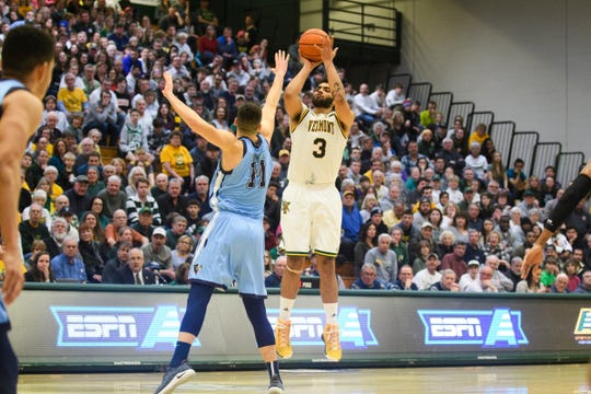 Vermont forward Anthony Lamb (3) shoots the ball over Maine's Lila Stojiljkovic (11) during the America East quarterfinal basketball game between the Maine Black Bears and the Vermont Catamounts at Patrick Gym on Saturday night March 9, 2019 in Burlington, Vermont.