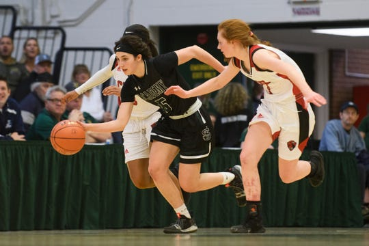 St. Johnsbury's Sadie Stetson (5) dribbles the ball down the court past CVU's Catherine Gilwee (4) and Mekkena Boyd (3) during the Division I girls basketball championship last month.