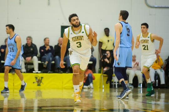 Vermont forward Anthony Lamb (3) celebrates after making a three pointer during the America East quarterfinal basketball game between the Maine Black Bears and the Vermont Catamounts at Patrick Gym on Saturday night March 9, 2019 in Burlington, Vermont.