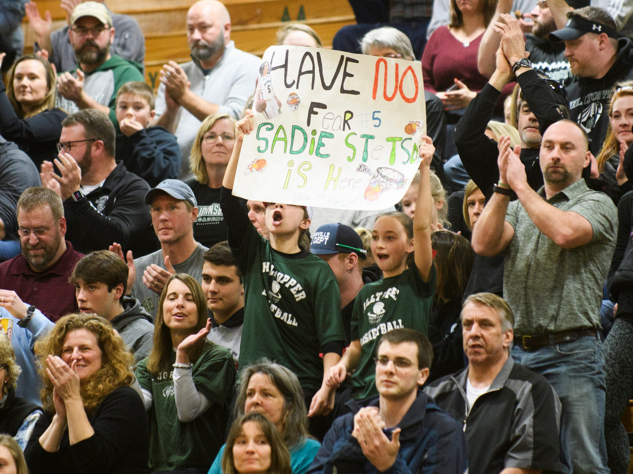 St. Johnsbury fans holds up a sign during the division I girls basketball championship basketball game between the St. Johnsbury Hilltoppers and the Champlain Valley Union Redhawks at Patrick Gym on Sunday afternoon March 10, 2019 in Burlington, Vermont.
