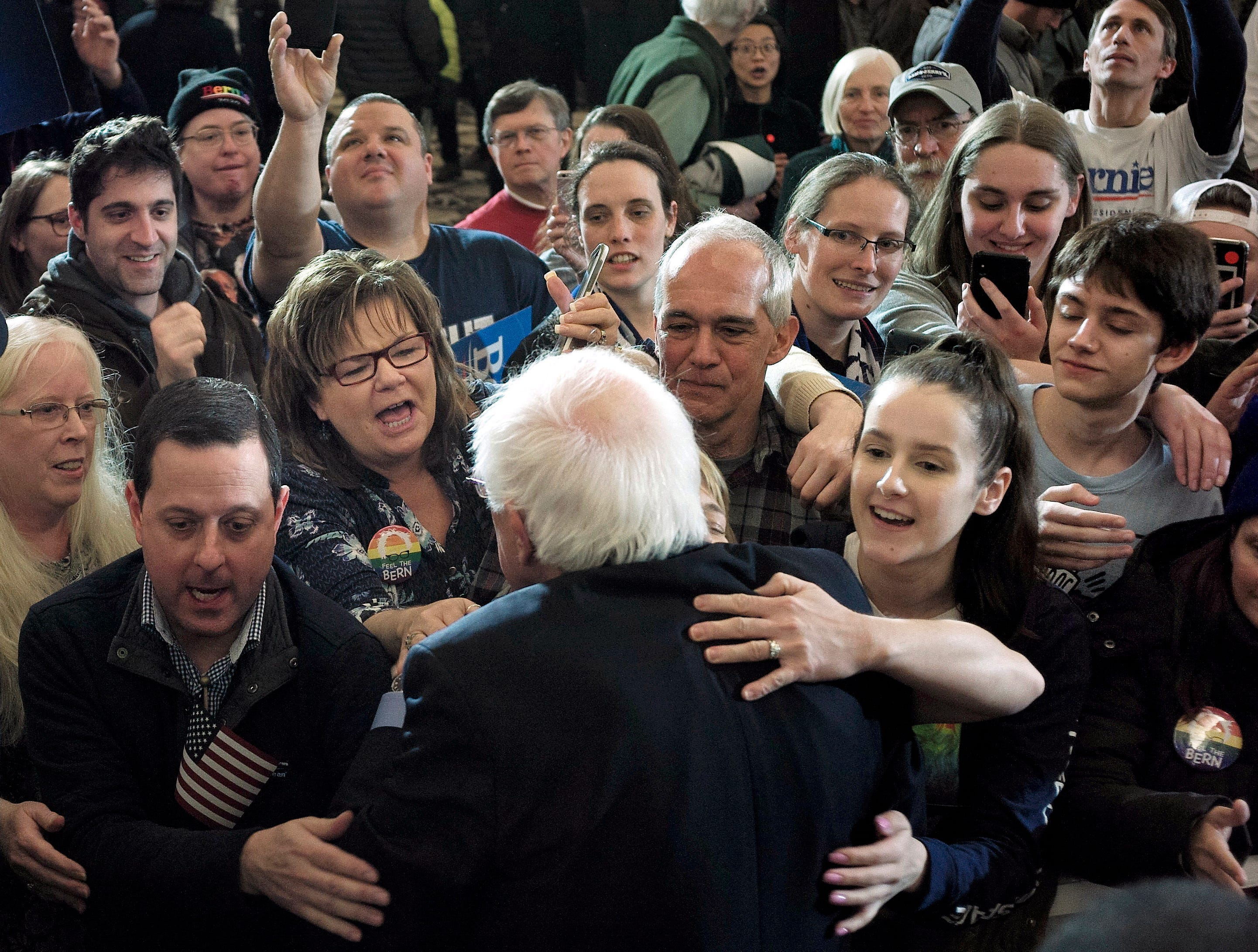 2020 Democratic presidential candidate Sen. Bernie Sanders, front, greets people in the audience after addressing a rally during a campaign stop Sunday, March 10, 2019, in Concord, N.H.