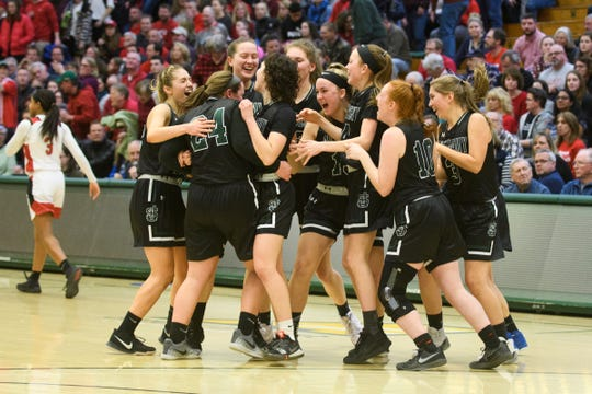 St. Johnsbury celebrates the championship during the division I girls basketball championship basketball game between the St. Johnsbury Hilltoppers and the Champlain Valley Union Redhawks at Patrick Gym on Sunday afternoon March 10, 2019 in Burlington, Vermont.