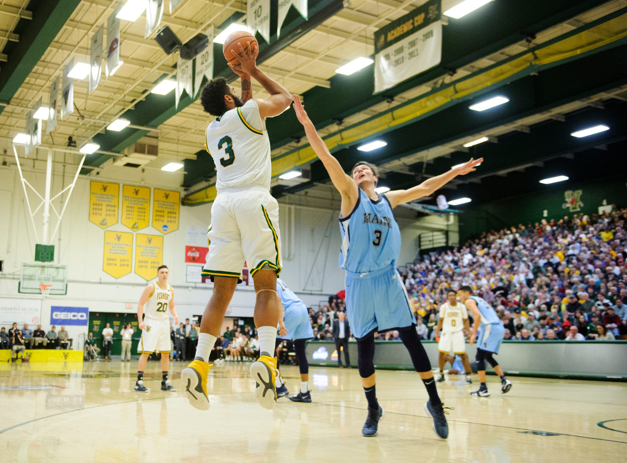 Vermont forward Anthony Lamb (3) shoots the ball over Maine's Vilgot Larsson (3) during the America East quarterfinal basketball game between the Maine Black Bears and the Vermont Catamounts at Patrick Gym on Saturday night March 9, 2019 in Burlington, Vermont.