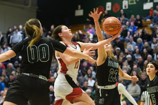 CVU's Quinn Boardman (10) leaps for a lay up during the division I girls basketball championship basketball game between the St. Johnsbury Hilltoppers and the Champlain Valley Union Redhawks at Patrick Gym on Sunday afternoon March 10, 2019 in Burlington, Vermont.