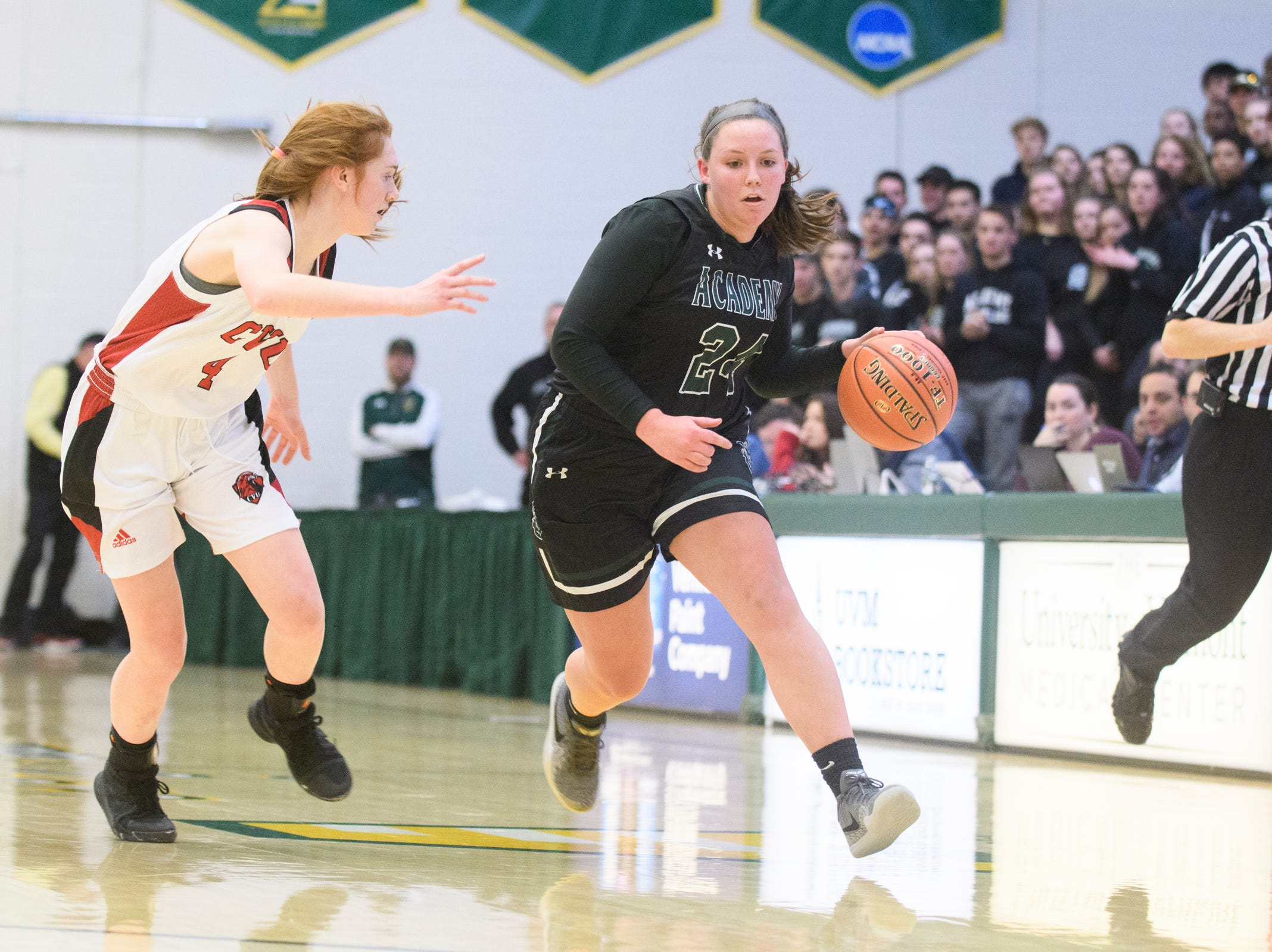 St. Johnsbury's Josie Choiniere (24) dribbles the ball down the court past CVU's Catherine Gilwee (4) during the division I girls basketball championship basketball game between the St. Johnsbury Hilltoppers and the Champlain Valley Union Redhawks at Patrick Gym on Sunday afternoon March 10, 2019 in Burlington, Vermont.
