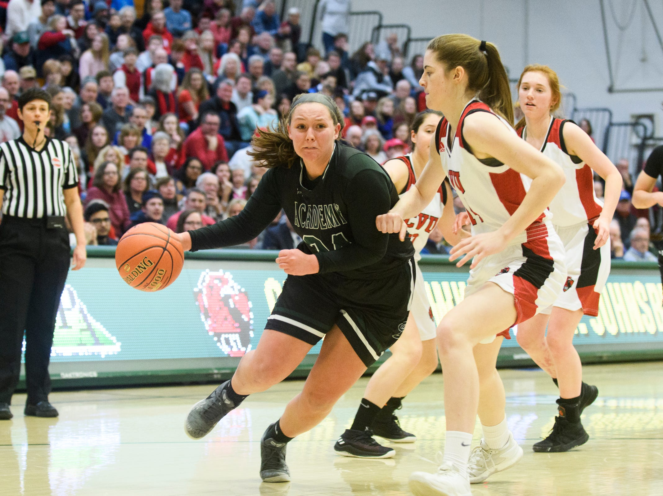St. Johnsbury's Josie Choiniere (24) drives to the hoop past CVU's Julia Balance (14) during the division I girls basketball championship basketball game between the St. Johnsbury Hilltoppers and the Champlain Valley Union Redhawks at Patrick Gym on Sunday afternoon March 10, 2019 in Burlington, Vermont.
