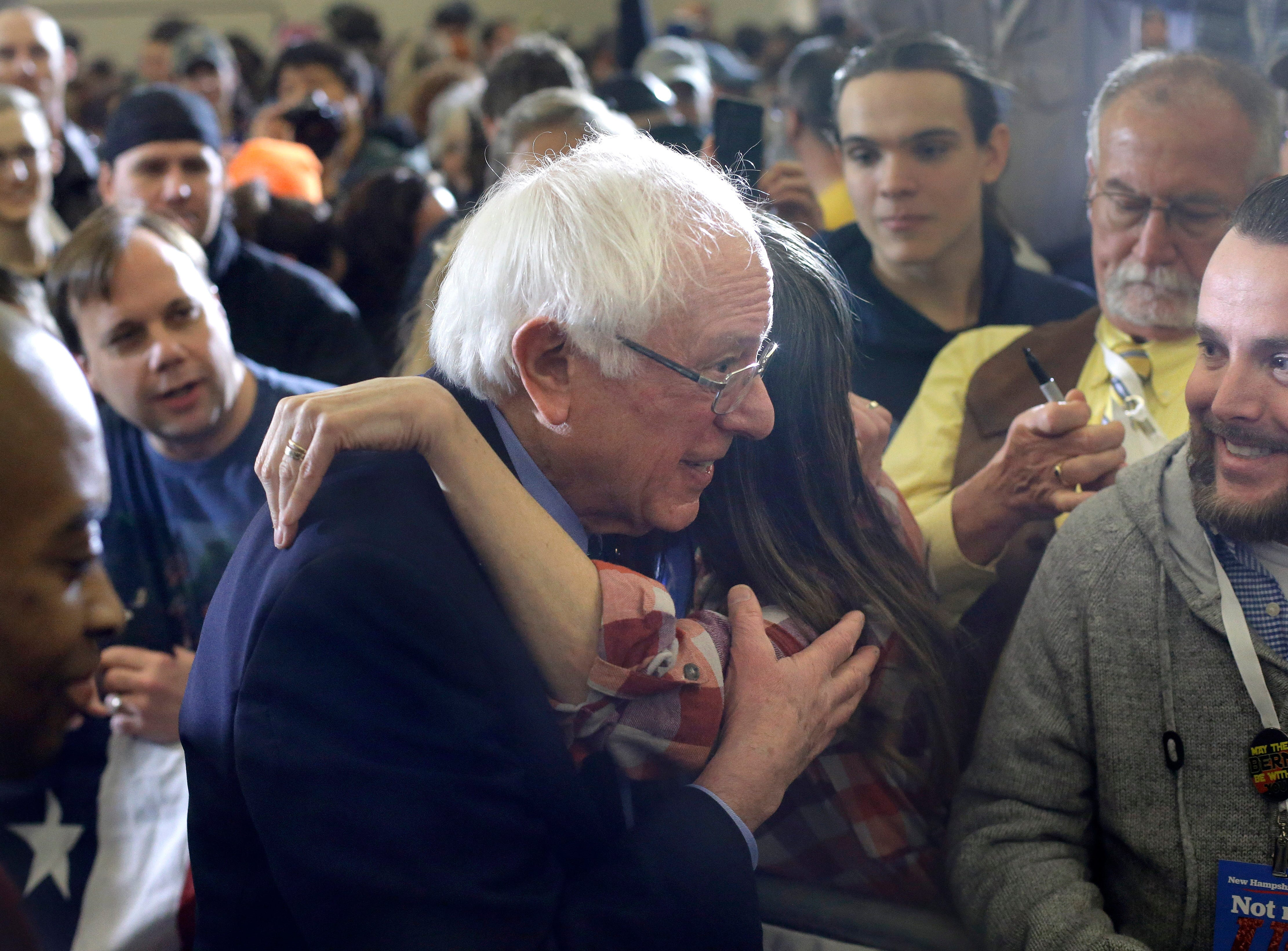 2020 Democratic presidential candidate Sen. Bernie Sanders, center, greets people in the audience after addressing a rally during a campaign stop, Sunday, March 10, 2019, in Concord, N.H.