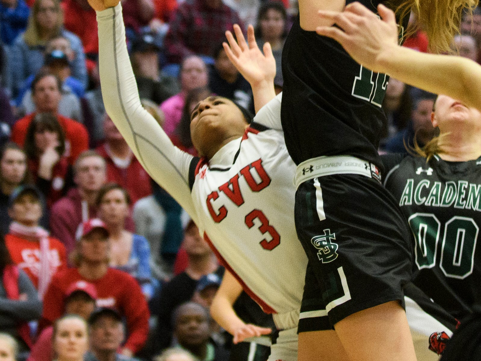 St. Johnsbury's Lara Rohkohl (12) blocks the shot by CVU's Mekkena Boyd (3) during the division I girls basketball championship basketball game between the St. Johnsbury Hilltoppers and the Champlain Valley Union Redhawks at Patrick Gym on Sunday afternoon March 10, 2019 in Burlington, Vermont.