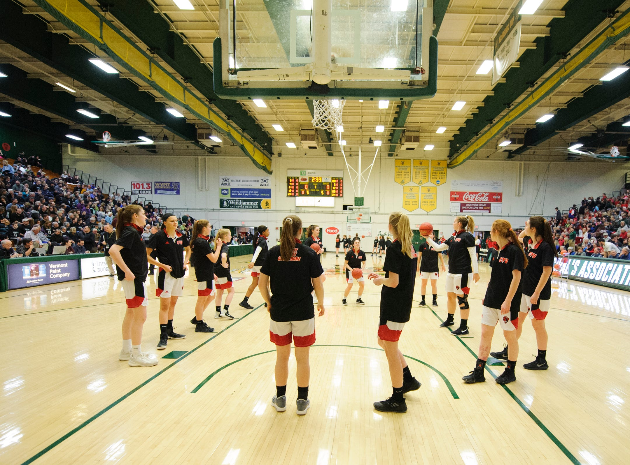 CVU warms up during the division I girls basketball championship basketball game between the St. Johnsbury Hilltoppers and the Champlain Valley Union Redhawks at Patrick Gym on Sunday afternoon March 10, 2019 in Burlington, Vermont.