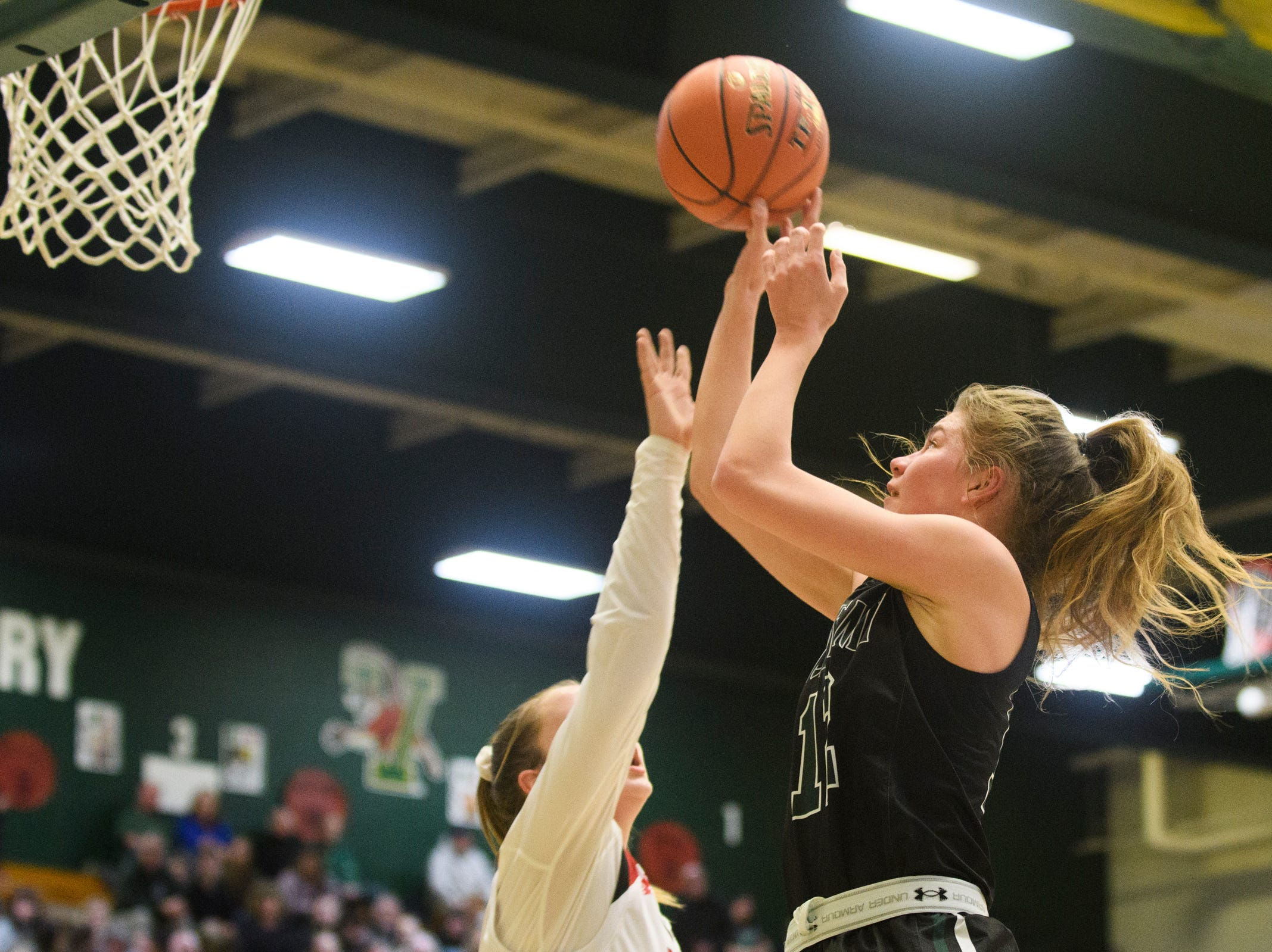 St. Johnsbury's Lara Rohkohl (12) leaps to take a shot during the division I girls basketball championship basketball game between the St. Johnsbury Hilltoppers and the Champlain Valley Union Redhawks at Patrick Gym on Sunday afternoon March 10, 2019 in Burlington, Vermont.