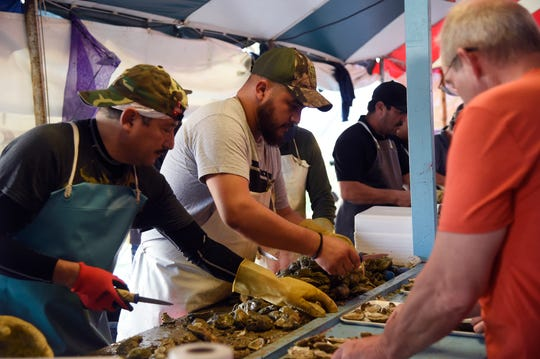 Volunteers shuck oysters during the Fulton Oysterfest, Saturday, March 9, 2019. The oysters were sourced along the Texas Gulf Coast.