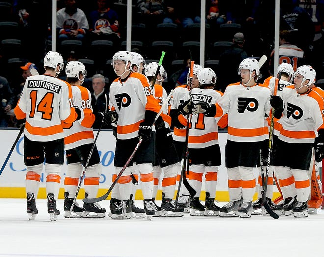 Mar 9, 2019; Uniondale, NY, USA; The Philadelphia Flyers celebrate after defeating the New York Islanders at Nassau Veterans Memorial Coliseum. Mandatory Credit: Andy Marlin-USA TODAY Sports
