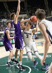 Adena senior Zach Fout scored two of his 14 points against Chesapeake Saturday night in Division III district final game at Ohio University's Convocation Center in Athens, Ohio, on March 9, 2019.
