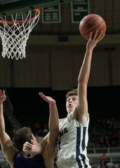 Adena senior Logan Bennett scored two of his seventeen points against Chesapeake Saturday night in Division III district final game at Ohio University's Convocation Center in Athens, Ohio, on March 9, 2019.
