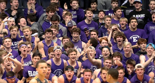 Elder students cheer on the Panthers during their district basketball game against Springfield, Saturday, March 9, 2019.