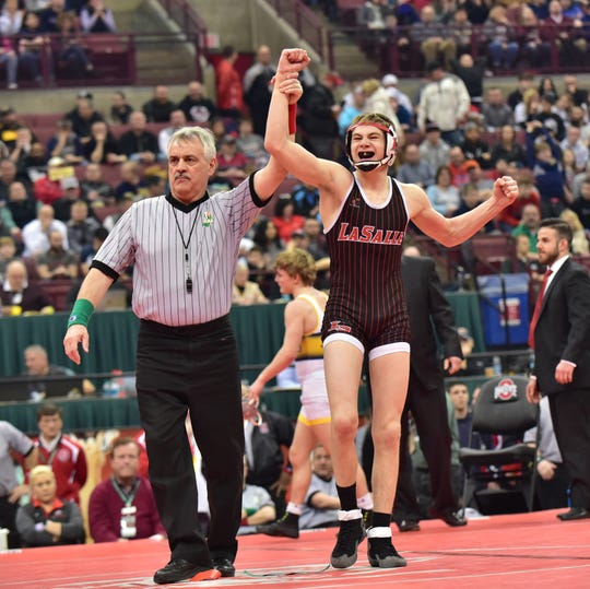 Dustin Norris of La Salle celebrates his championship in the 113 lbs. weight class at the Division I  OHSAA individual state wrestling tournament at Ohio State, March 9, 2019.