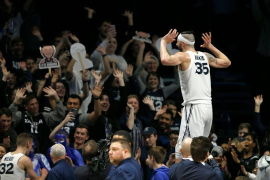 "Xavier Musketeers forward Zach Hankins (35) ""raises the roof"" with the student section after the second half of the NCAA Big East game between the Xavier Musketeers and the St. John's Red Storm at the Cintas Center in Cincinnati on Saturday, March 9, 2019. Xavier won its final game of the regular season, 81-68."