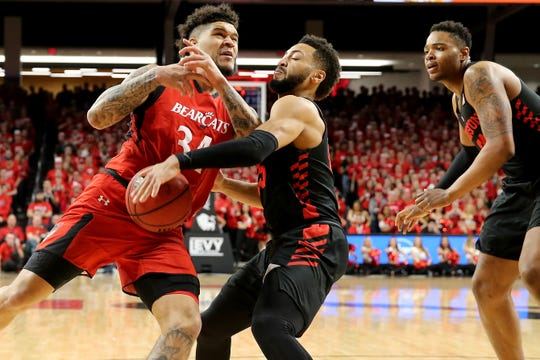 Houston Cougars guard Galen Robinson Jr. (25) strips the ball from Cincinnati Bearcats guard Jarron Cumberland (34) in the first half of an NCAA college basketball game, Sunday, March 10, 2019, at Fifth Third Arena in Cincinnati.