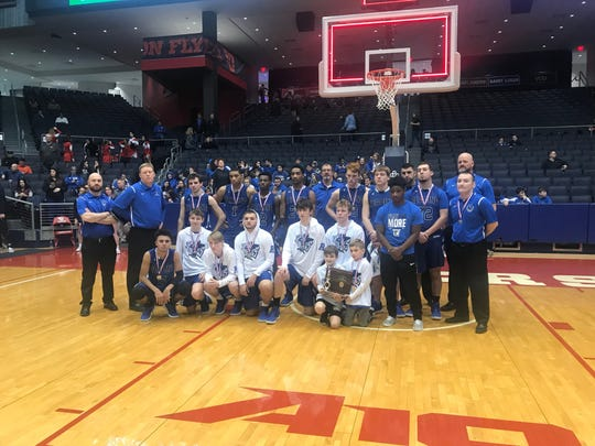 Reading poses with the district runner-up trophy following a 47-44 loss to Versailles in the championship game, Sunday March 10, 2009, at UD Arena.