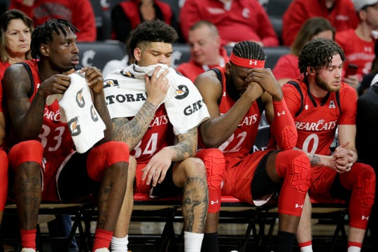 From left: Cincinnati Bearcats center Nysier Brooks (33), guard Jarron Cumberland (34), forward Eliel Nsoseme (22) and guard Logan Johnson (0) react to losing against the Houston Cougars in second half of an NCAA college basketball game, Sunday, March 10, 2019, at Fifth Third Arena in Cincinnati.