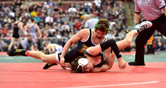 Mason's Christopher Donathan takes control in the 145 lbs. class at the Division I OHSAA individual state wrestling tournament at Ohio State, March 9, 2019.