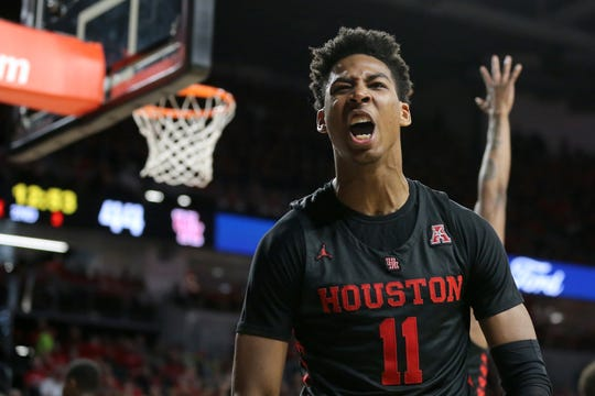Houston Cougars guard Nate Hinton (11) reacts to a made basket in the second half against Cincinnati on Sunday. The Cougars won the AAC regular-season title.