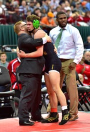 Mason's Christopher Donathan receives congratulations after winning the 145 lbs. class championship at the Division I OHSAA individual state wrestling tournament at Ohio State, March 9, 2019.