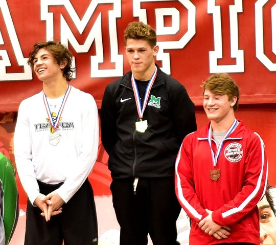 Mason's Christopher Donathan sports his medal at the top of the platform for winning the 145 lbs. class title at the Division I OHSAA individual state wrestling tournament at Ohio State, March 9, 2019.