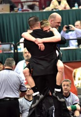 Neal Williams is gripped by La Salle's Dustin Norris after as Dustin brought home the 113 lbs. weight class title at  the Division I OHSAA individual state wrestling tournament at Ohio State, March 9, 2019.