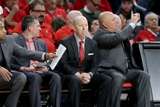 Cincinnati Bearcats head coach Mick Cronin, center, observes the game in the second half of an NCAA college basketball game against the Houston Cougars, Sunday, March 10, 2019, at Fifth Third Arena in Cincinnati.