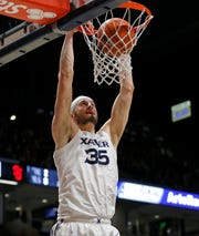 Xavier Musketeers forward Zach Hankins (35) throws down a dunk in the second half of the NCAA Big East game between the Xavier Musketeers and the St. John's Red Storm at the Cintas Center in Cincinnati on Saturday, March 9, 2019. Xavier won its final game of the regular season, 81-68.