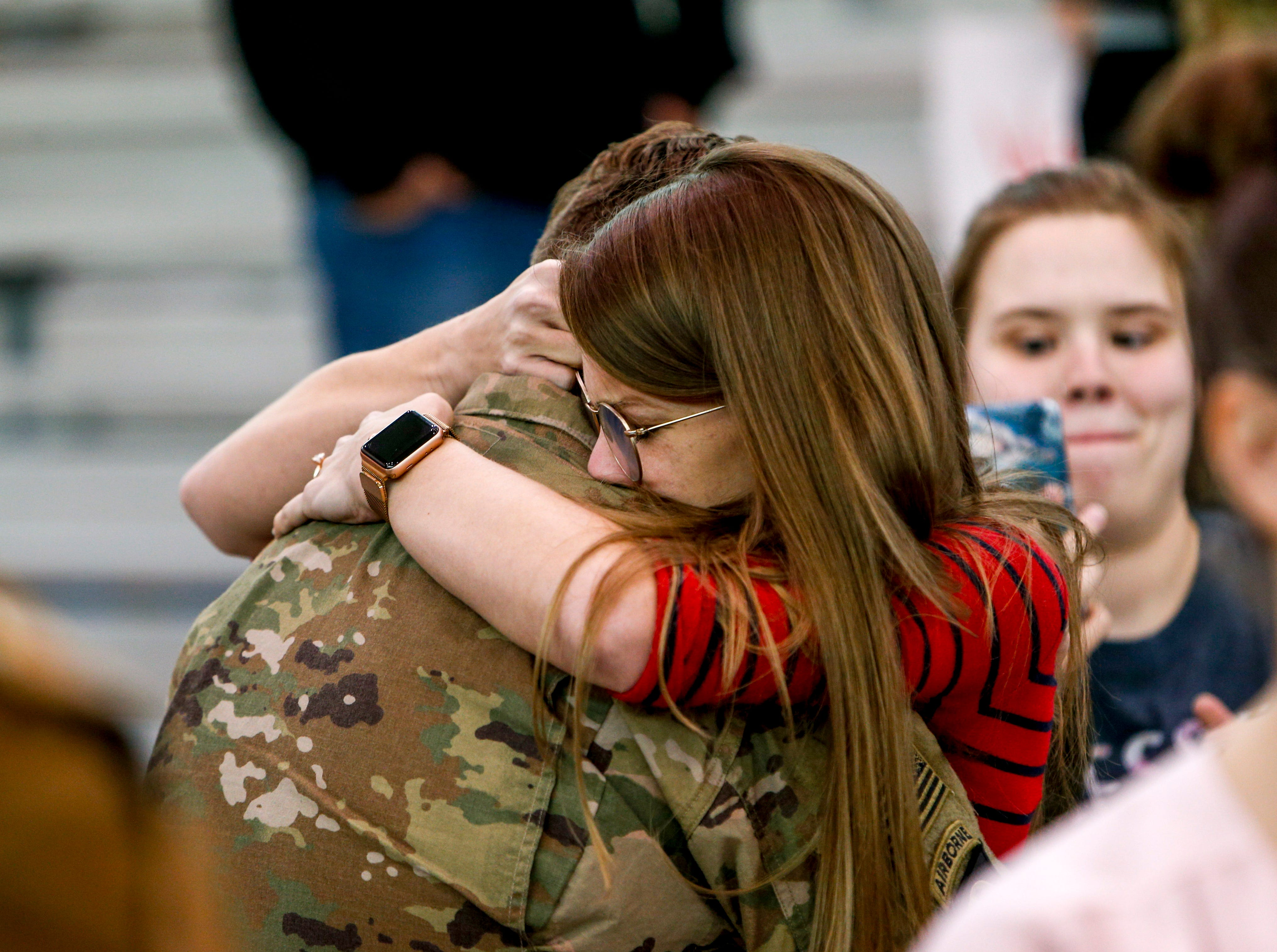 Loved ones welcome troops coming home from deployment in Afghanistan during the return of soldiers from the 101st Combat Aviation Brigade of 101st Airborne Division (Air Assault) at Campbell Army Air Field in Fort Campbell, KY., on Sunday, March 10, 2019.