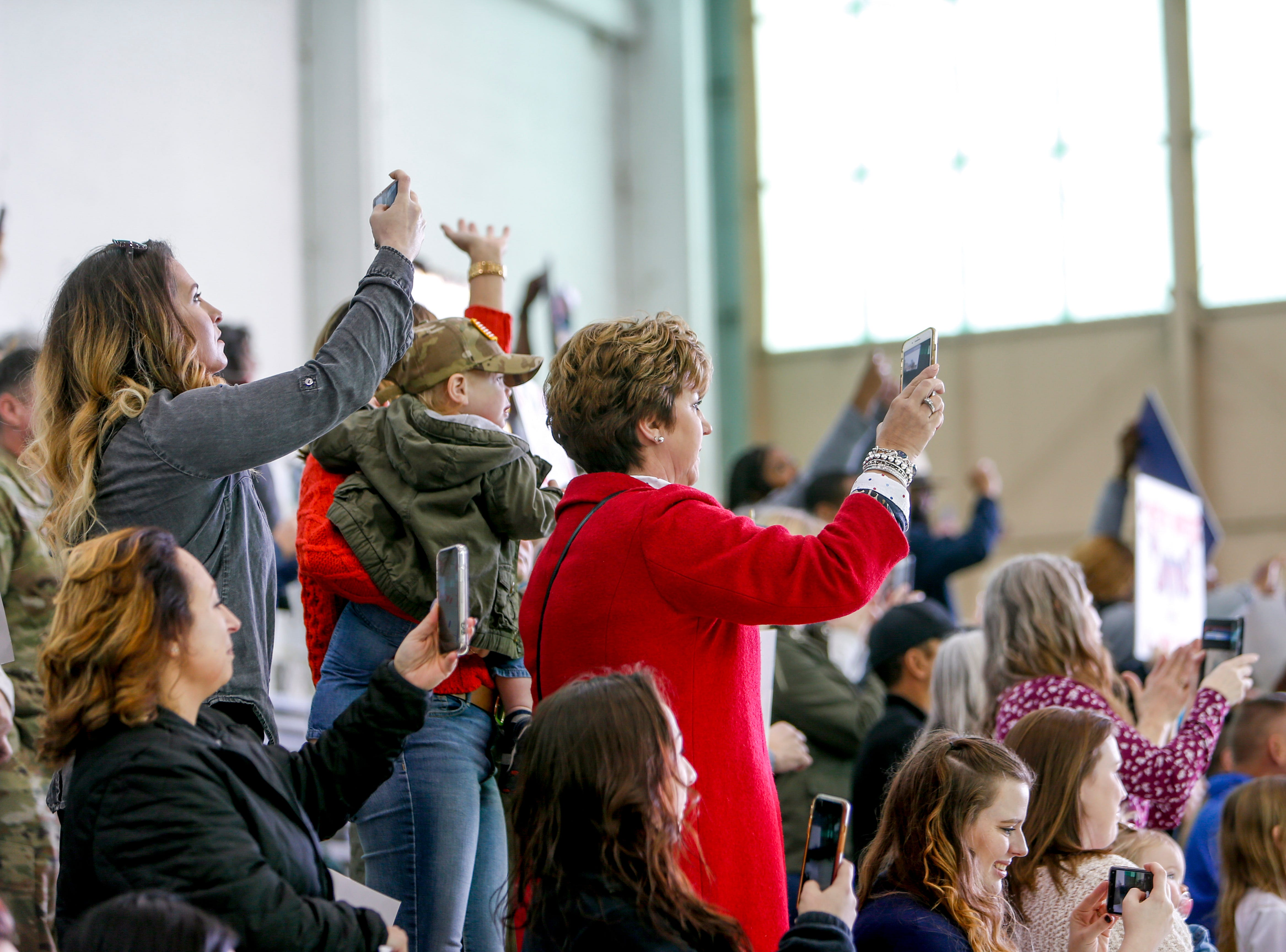 Family members and loved ones take pictures of troops coming home from deployment in Afghanistan during the return of soldiers from the 101st Combat Aviation Brigade of 101st Airborne Division (Air Assault) at Campbell Army Air Field in Fort Campbell, KY., on Sunday, March 10, 2019.