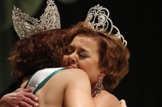 Ashley Allsbrooks, Ms. Houston County 2018, hugs and congratulates 2019 Ms. Houston County Clysta Ellingson on Saturday, March 9, 2019.
