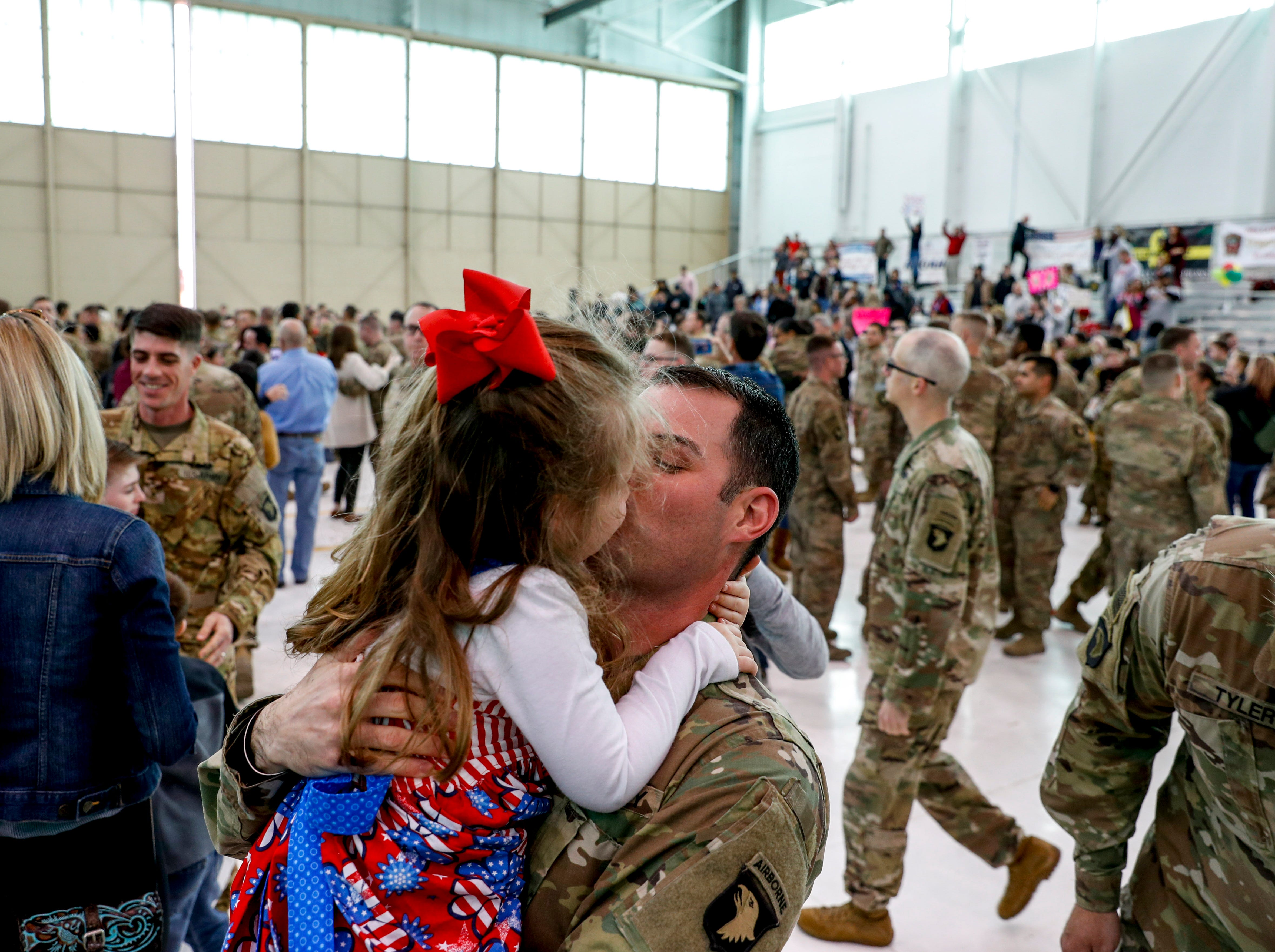Maj. Greg Sterley lifts up and kisses his daughter Allison Sterley, 4, after seeing her for the first time upon return from his deployment in Afghanistan during the return of soldiers from the 101st Combat Aviation Brigade of 101st Airborne Division (Air Assault) at Campbell Army Air Field in Fort Campbell, KY., on Sunday, March 10, 2019.
