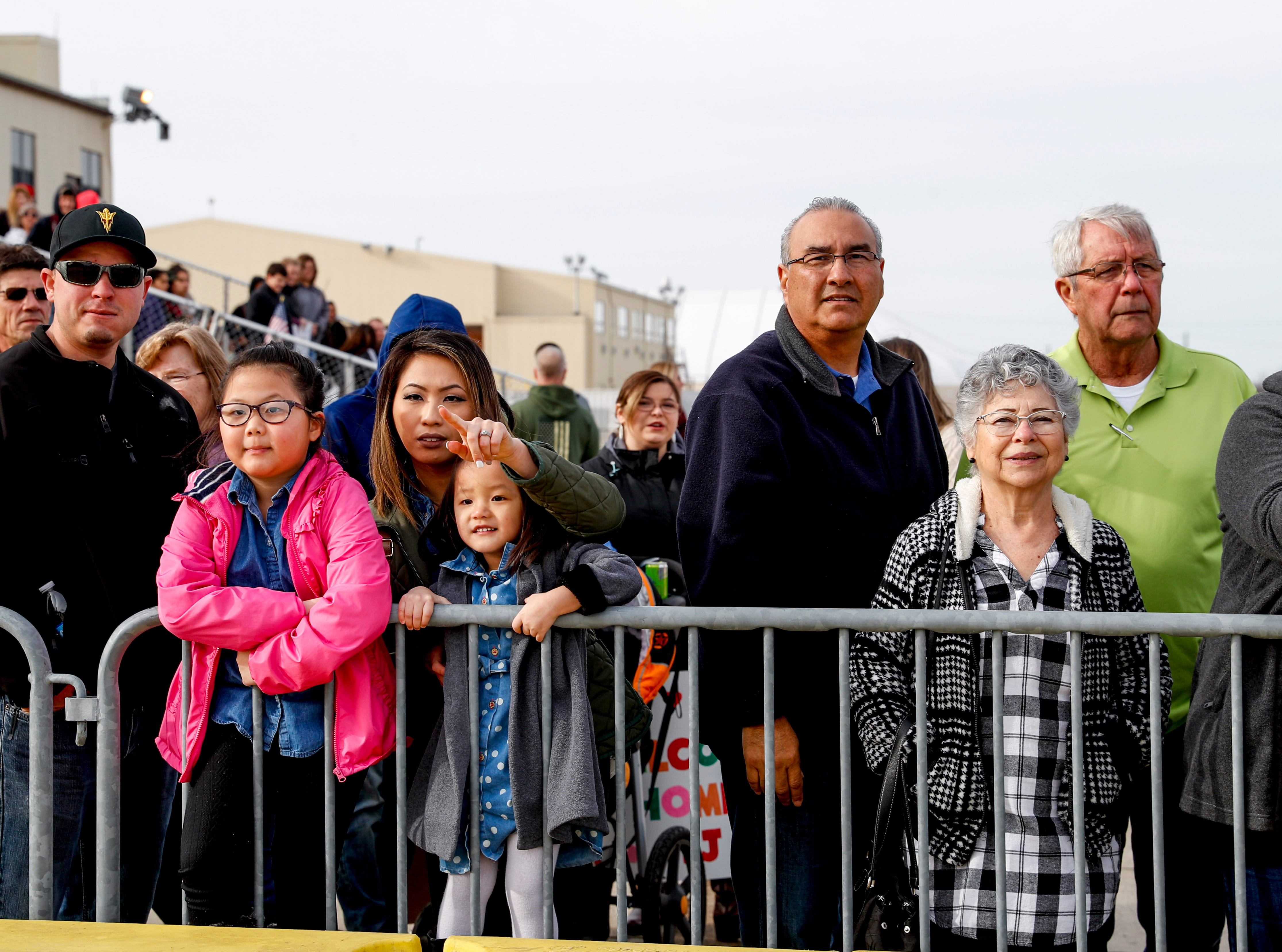 Families point at and watch the approach of an airplane carrying 227 troops coming home from Afghanistan during the return of soldiers from the 101st Combat Aviation Brigade of 101st Airborne Division (Air Assault) at Campbell Army Air Field in Fort Campbell, KY., on Sunday, March 10, 2019.