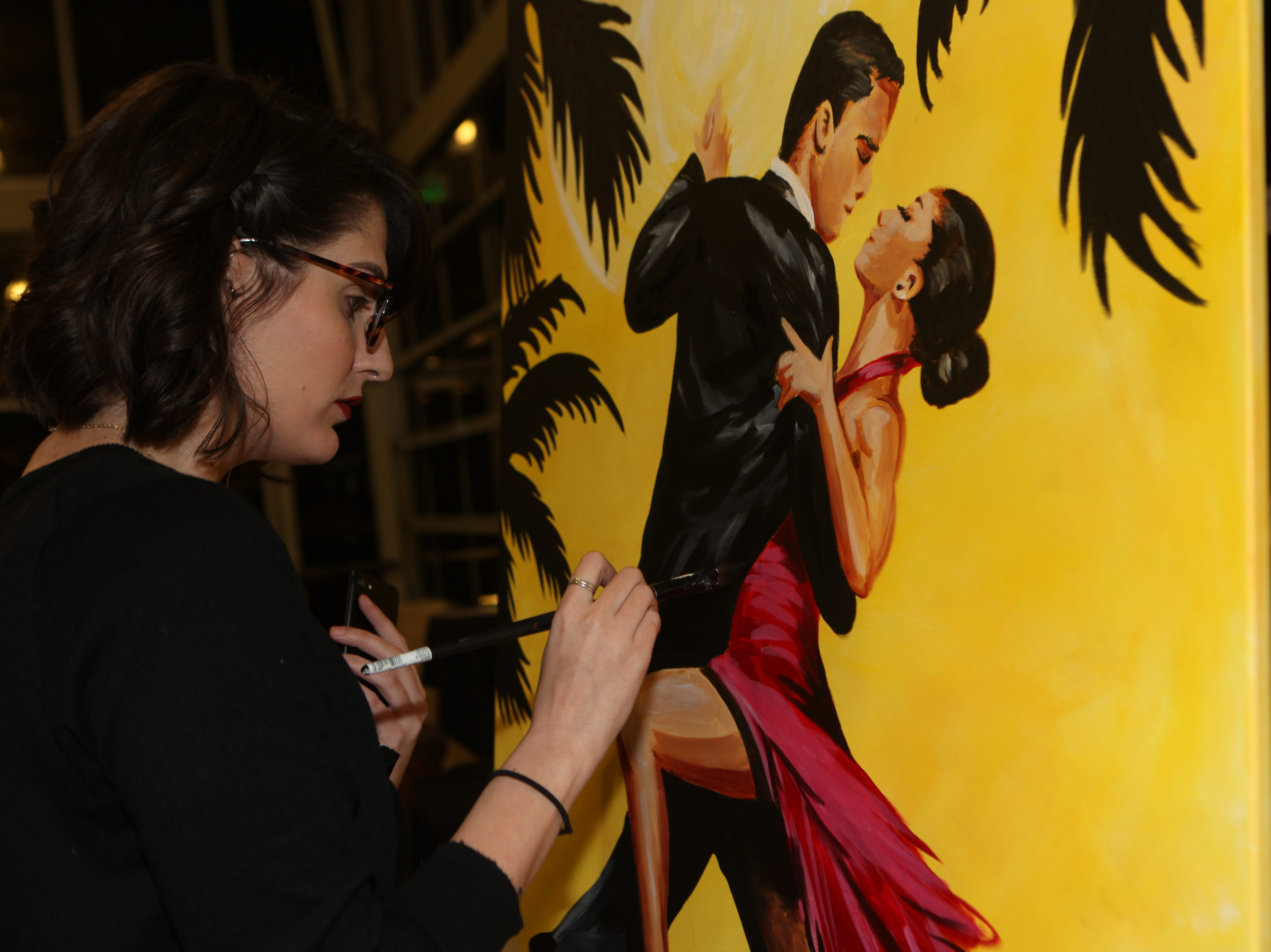 Amy Scheren captures the spirit of Havana nights in a painting done live and auctioned at the Fort Campbell Spouses Club Very Important Charity Event on March 9, 2019.