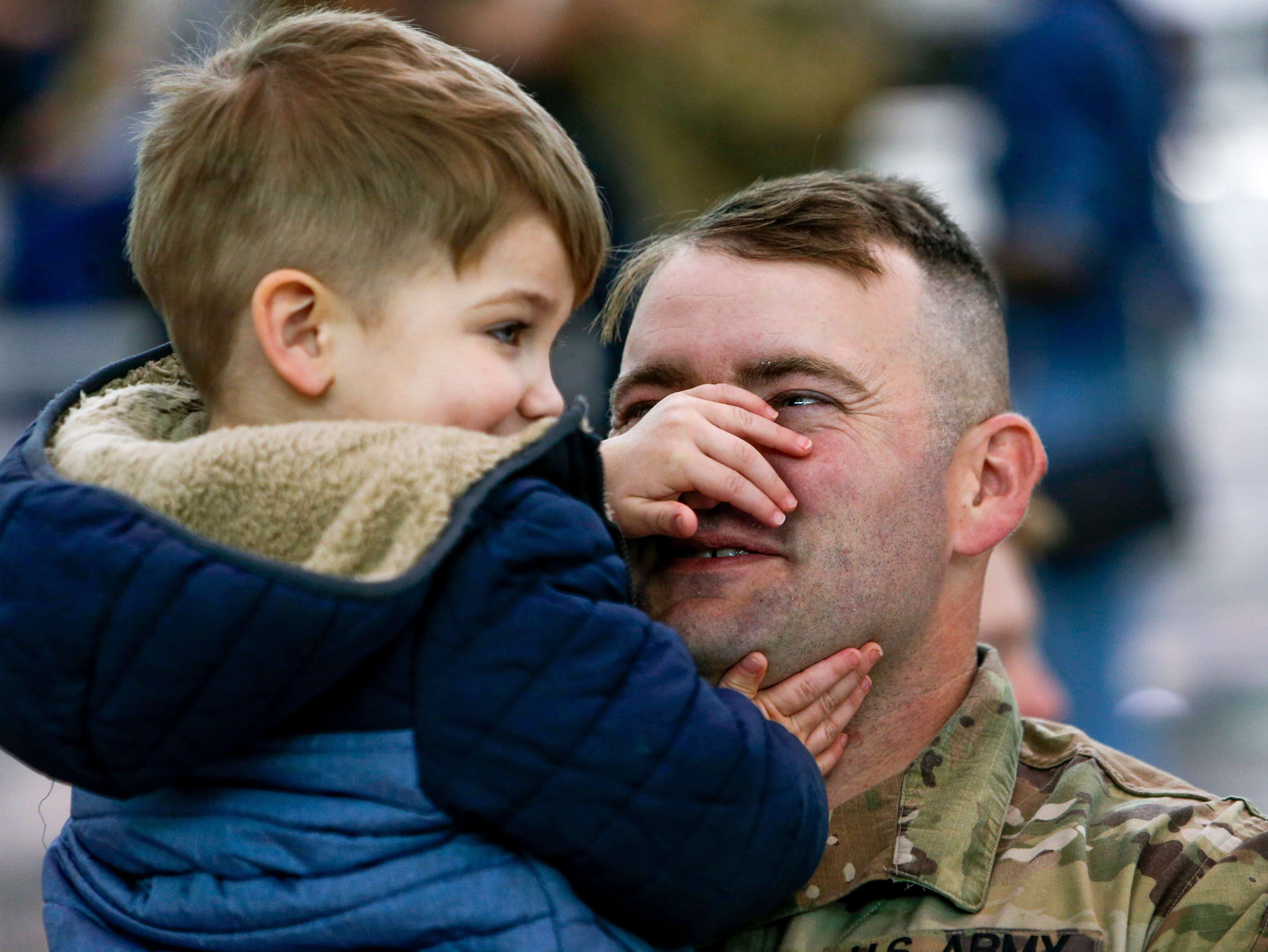 Kenneth Tyler holds up his son Roland Tyler, 2, while seeing him for the first time after deployment during the return of soldiers from the 101st Combat Aviation Brigade of 101st Airborne Division (Air Assault) at Campbell Army Air Field in Fort Campbell, KY., on Sunday, March 10, 2019.
