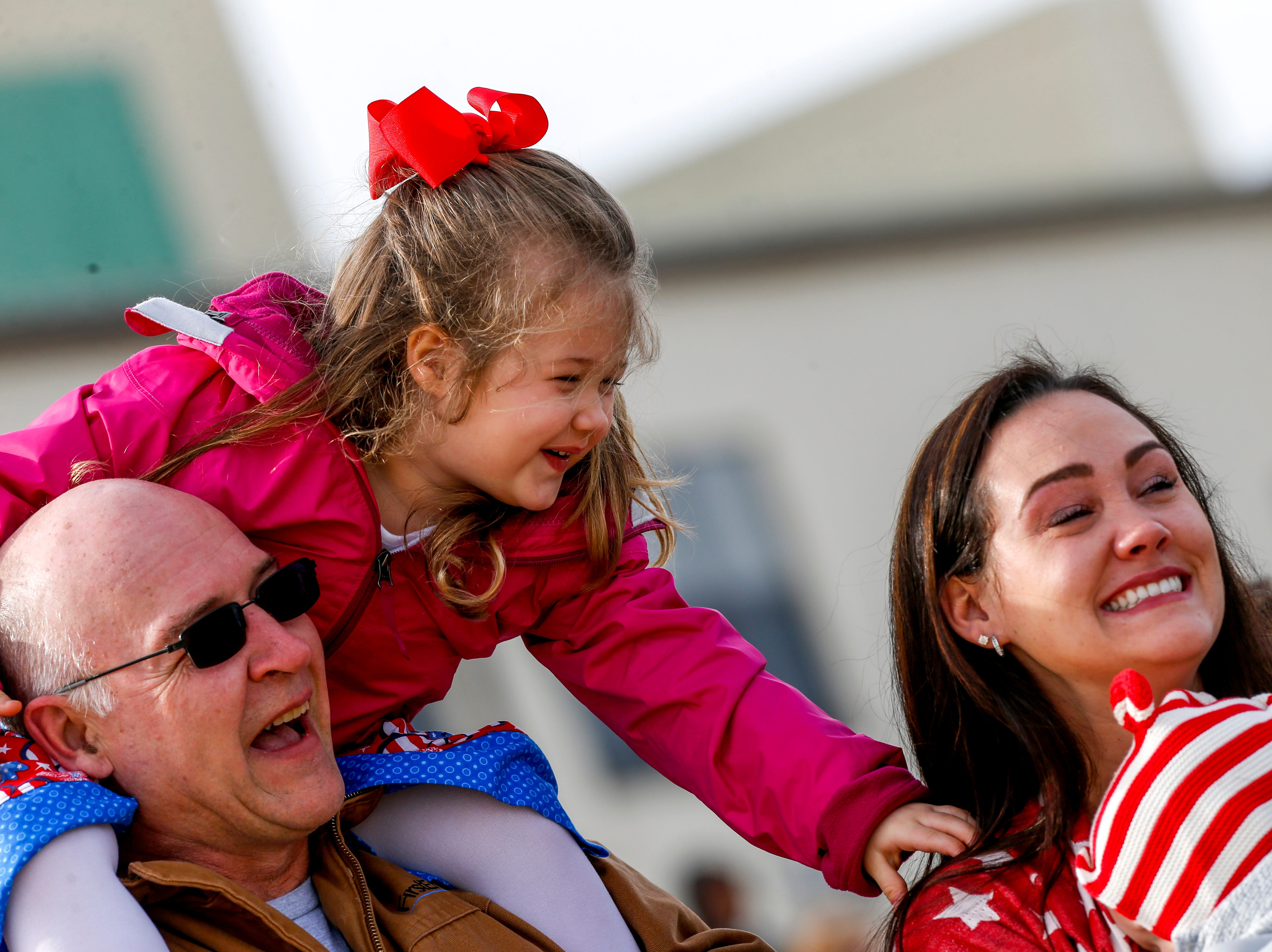 Allison Sterley, 4, tugs on her mother Jessica Sterley's, right, shoulder when realizing her dad is coming home during the return of soldiers from the 101st Combat Aviation Brigade of 101st Airborne Division (Air Assault) at Campbell Army Air Field in Fort Campbell, KY., on Sunday, March 10, 2019.