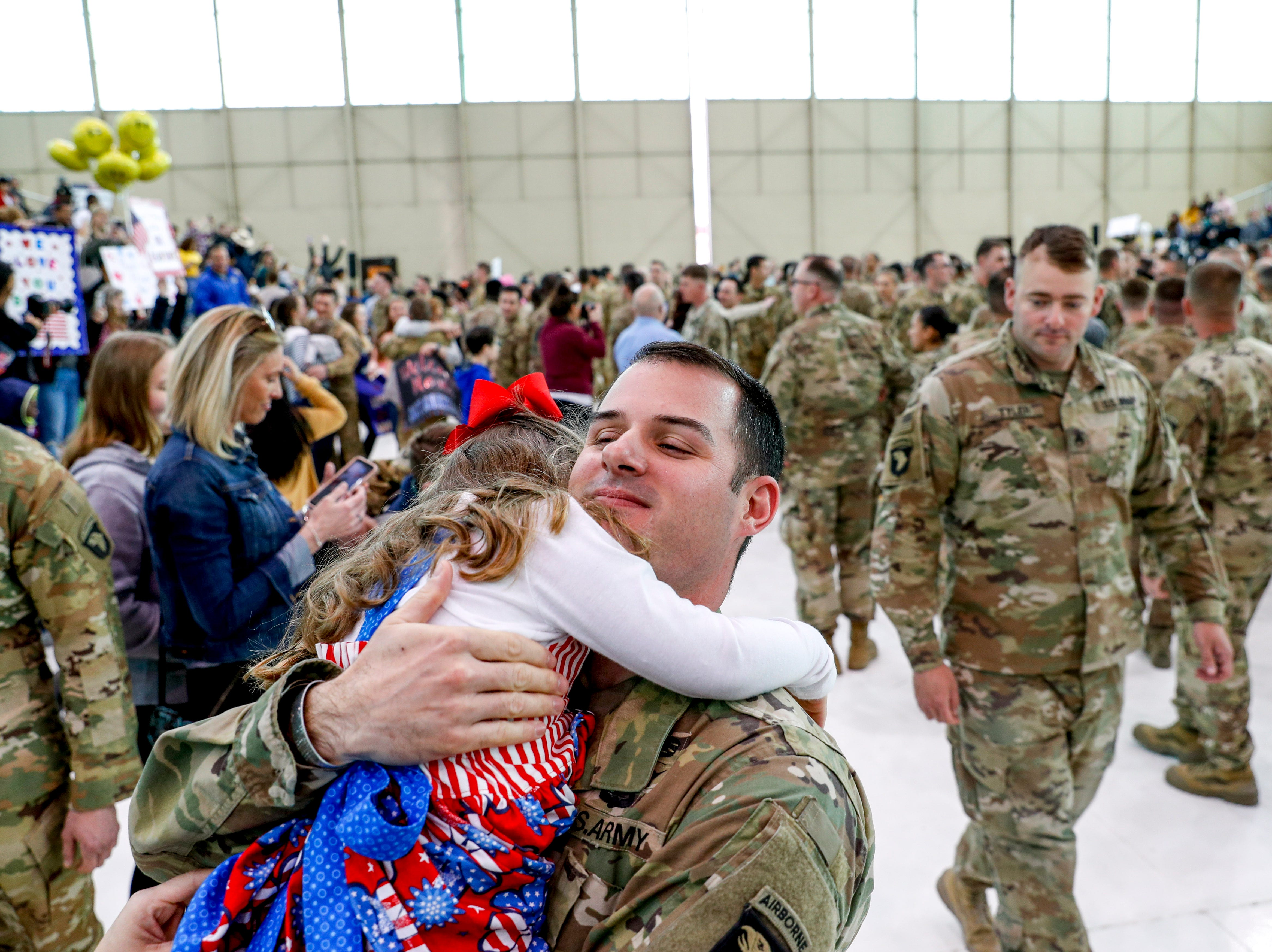Maj. Greg Sterley embraces his daughter Allison Sterley, 4, seeing her for the first time during the return of soldiers from the 101st Combat Aviation Brigade of 101st Airborne Division (Air Assault) at Campbell Army Air Field in Fort Campbell, KY., on Sunday, March 10, 2019.