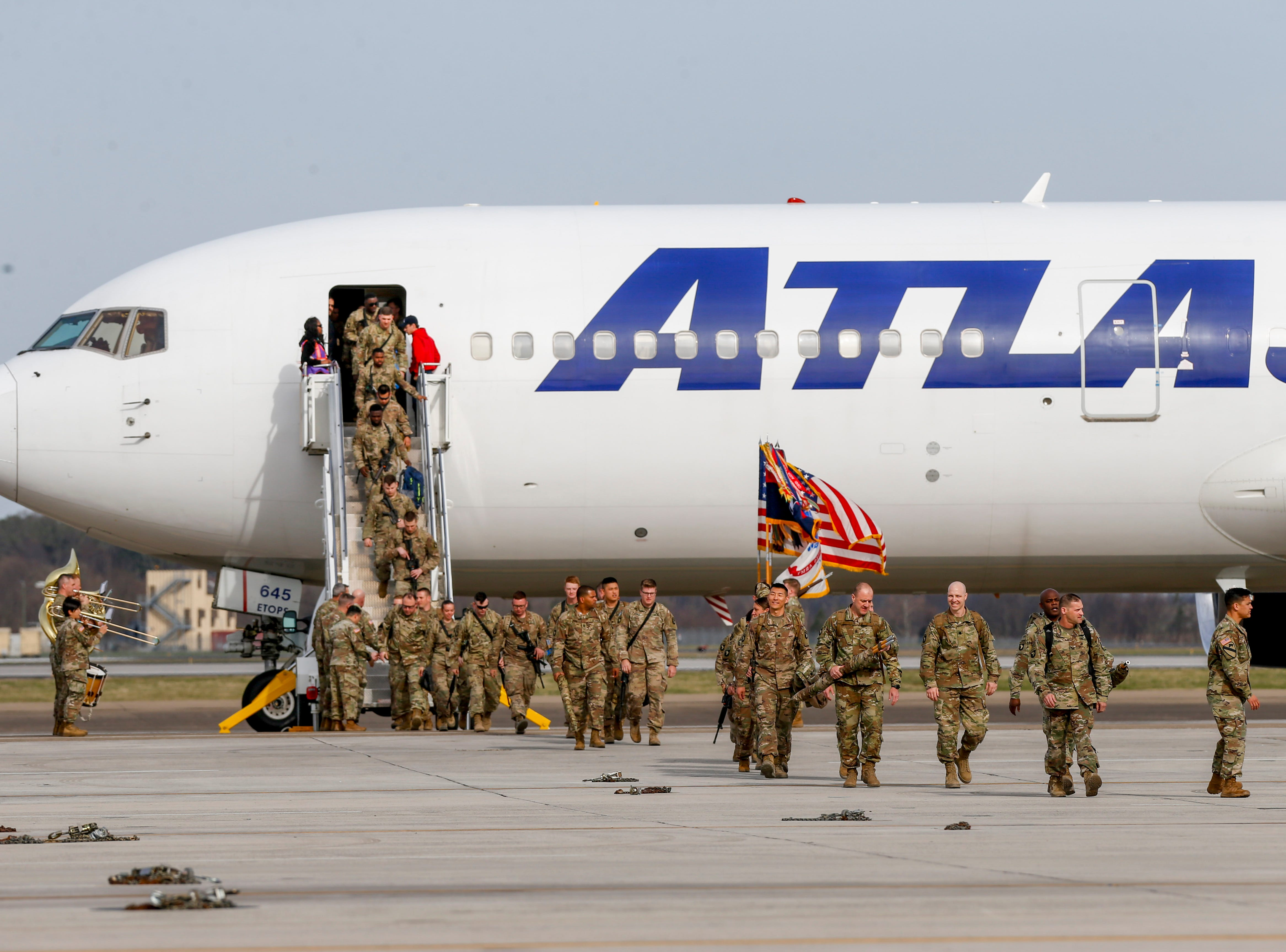 Troops walk off of the airplane during the return of soldiers from the 101st Combat Aviation Brigade of 101st Airborne Division (Air Assault) at Campbell Army Air Field in Fort Campbell, KY., on Sunday, March 10, 2019.