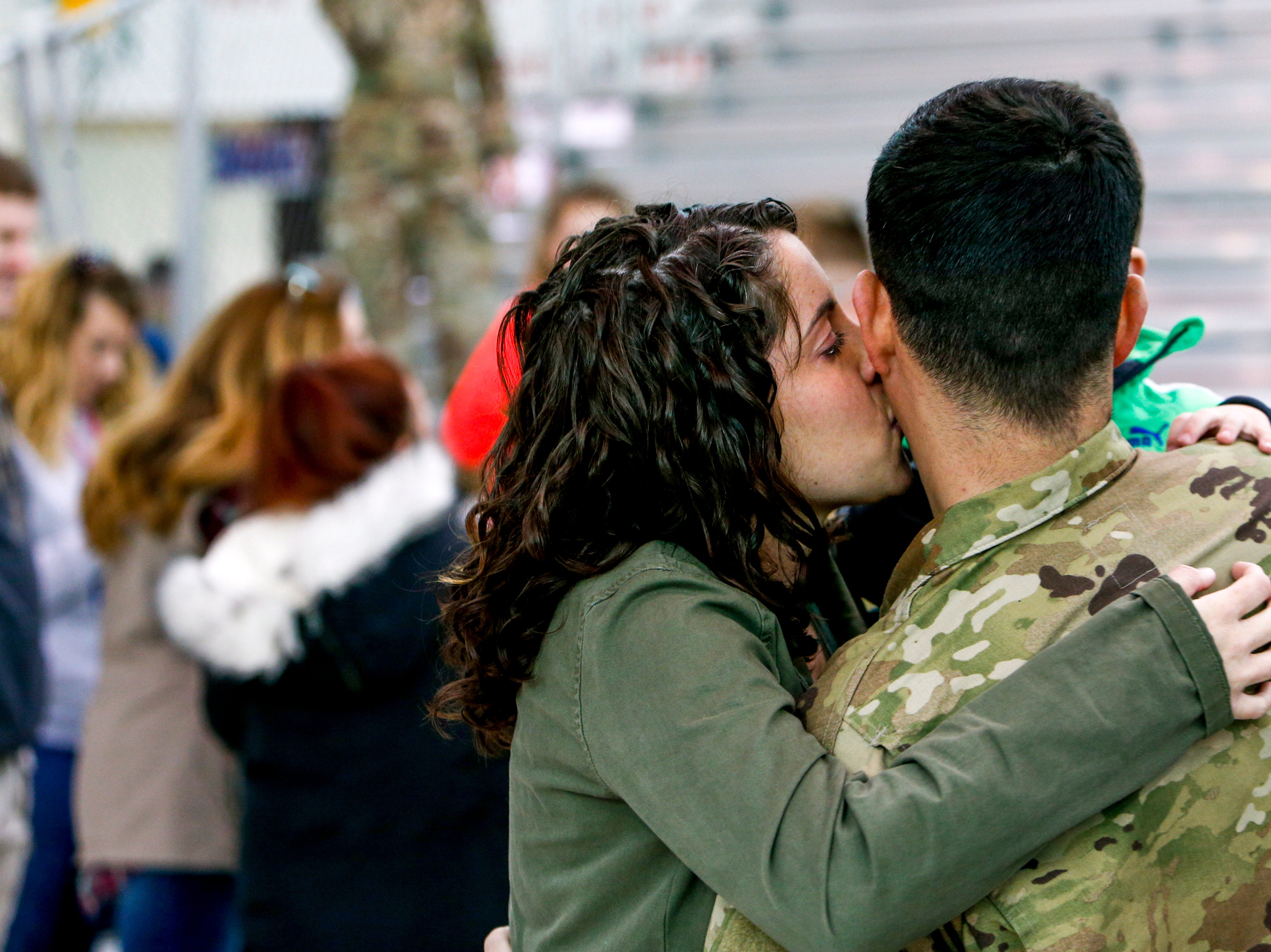 Heather Castanho embraces and kisses her husband Paulo Castanho, who was deployed in Afghanistan before seeing his family during the return of soldiers from the 101st Combat Aviation Brigade of 101st Airborne Division (Air Assault) at Campbell Army Air Field in Fort Campbell, KY., on Sunday, March 10, 2019.
