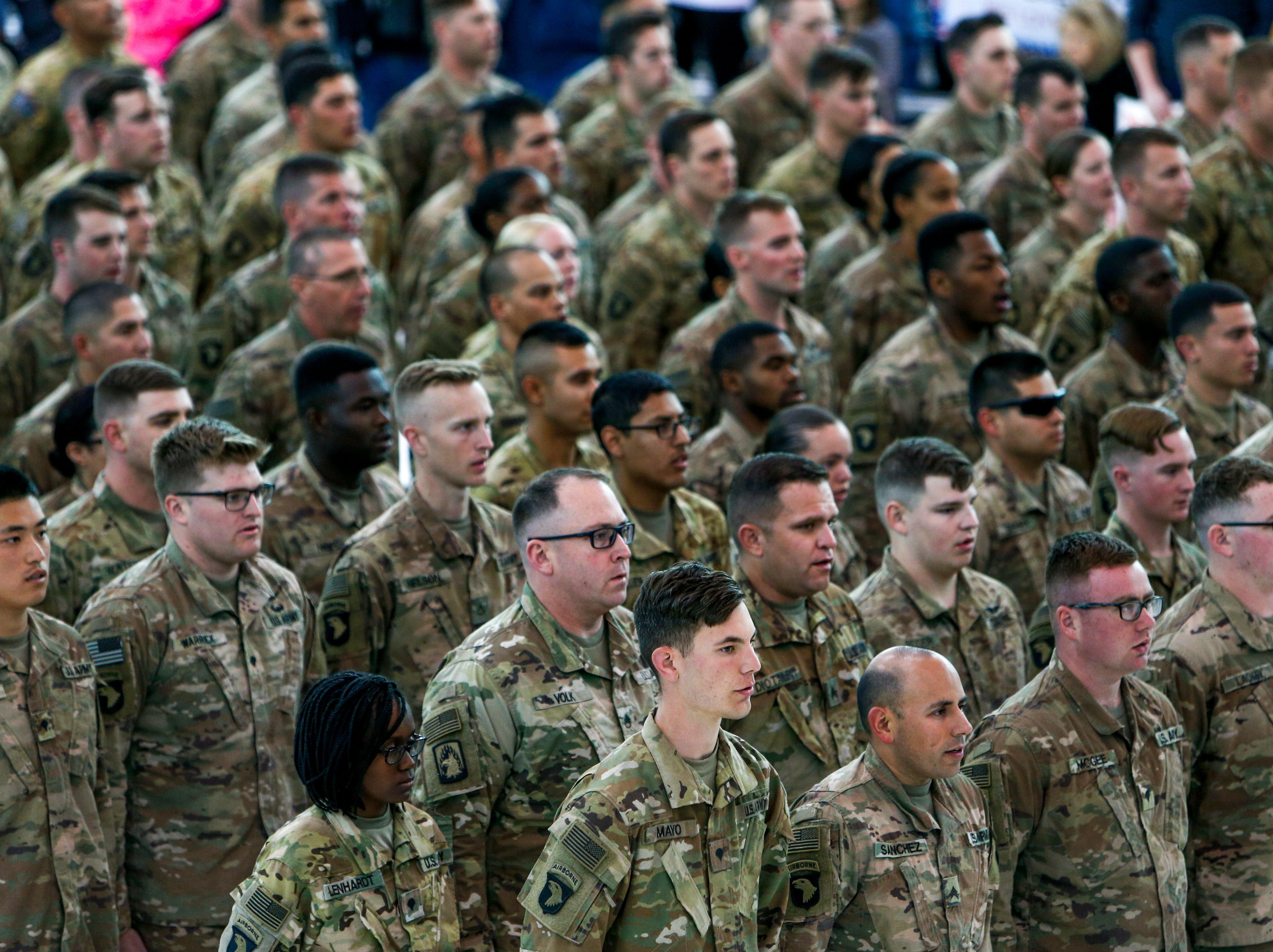 Troops stand at attention before being dismissed to see family during the return of soldiers from the 101st Combat Aviation Brigade of 101st Airborne Division (Air Assault) at Campbell Army Air Field in Fort Campbell, KY., on Sunday, March 10, 2019.