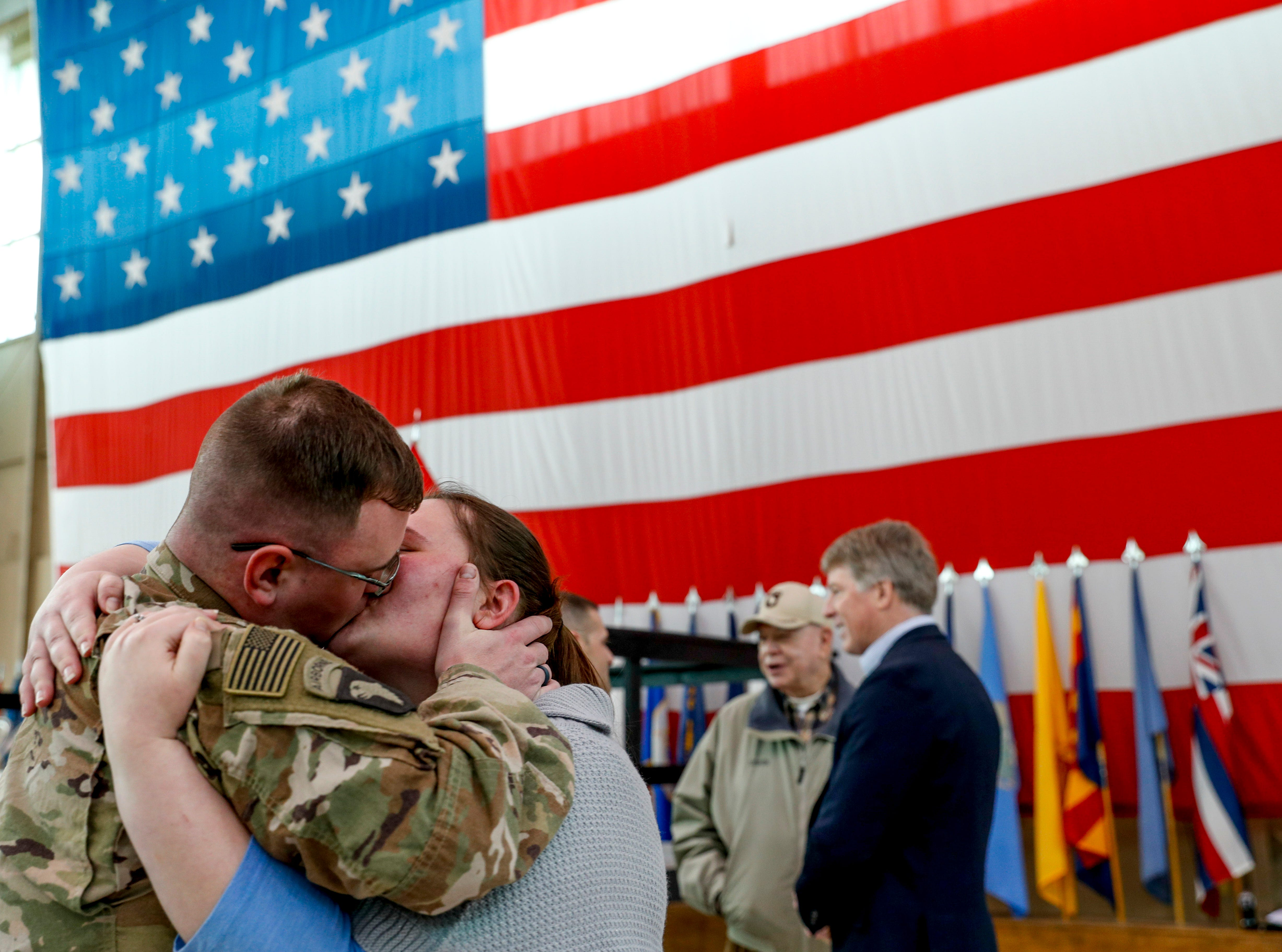 Sgt. William Hagen and Valerie Hagen embrace and kiss upon seeing one another during the return of soldiers from the 101st Combat Aviation Brigade of 101st Airborne Division (Air Assault) at Campbell Army Air Field in Fort Campbell, KY., on Sunday, March 10, 2019.